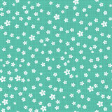 Little Cute Flowers on Green Checkered Background. Stock Photo