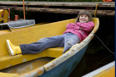 Little cute funny girl lying in boat Stock Photo