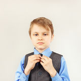 Little cute gentleman dresses his suit jacket Royalty Free Stock Photos