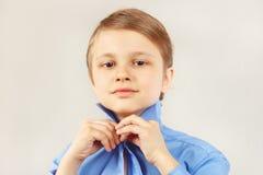 Little cute gentleman straighten collar of bright shirt Stock Image