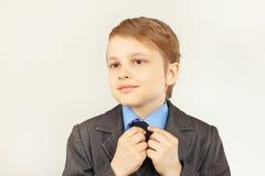 Little cute gentleman straighten collar of elegant suit Royalty Free Stock Image