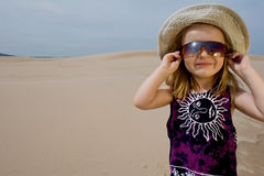 Little, cute girl. Little, cute girl wearing sunglasses and funny hat Stock Photos