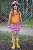 Little cute girl. In panama wearing rubber water mocassins. summer time Royalty Free Stock Images