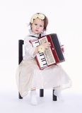 Little cute girl with accordion royalty free stock images
