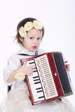 Little cute girl with accordion stock photo
