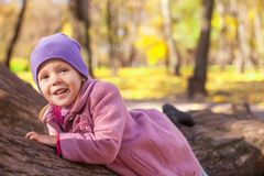 Little cute girl in autumn park on sunny day Royalty Free Stock Images
