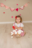 Little cute girl on the background wall of a house Royalty Free Stock Photo