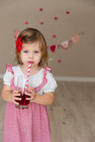 Little cute girl on the background wall of a house Royalty Free Stock Image