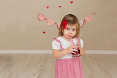 Little cute girl on the background wall of a house Royalty Free Stock Images