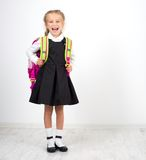 Little cute girl with a backpack Stock Images