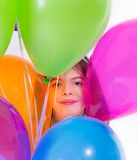 Little cute girl with balloons Stock Photo
