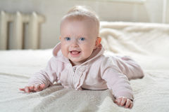 Little cute girl in a bathrobe a white Royalty Free Stock Photo