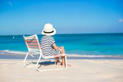 Little cute girl in beach chair relax on caribbean vacation Stock Photos