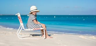 Little cute girl in beach chair relax on caribbean Stock Images