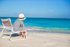 Little cute girl in beach chair relax on caribbean Stock Photography
