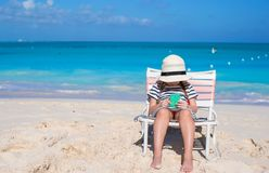 Little cute girl in beach chair relax on caribbean Stock Photos