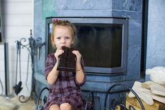Little cute girl with big chocolate Royalty Free Stock Image