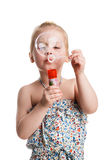 little cute girl blowing soap bubbles isolated on white backgrou Royalty Free Stock Images