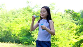 Little cute girl blowing soap bubbles Royalty Free Stock Images