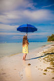 Little cute girl with blue umbrella walking on Royalty Free Stock Images