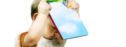 Little cute girl with a book Royalty Free Stock Photos