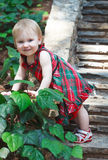 Little cute girl in a bright dress standing on the stairs with s Stock Images