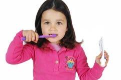 Little Cute Girl Brushing The Teeth