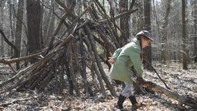 Little cute girl builds a hut stock video footage