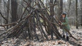 Little cute girl builds a hut stock footage