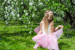 Little cute girl with butterfly wings in Royalty Free Stock Photo