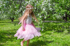 Little cute girl with butterfly wings have fun in Stock Photo