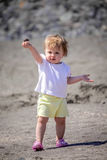 Little cute girl carrying a stone royalty free stock photography