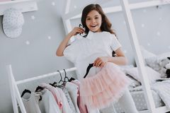 Little Cute Girl Choosing a Dress in Bedroom royalty free stock photography