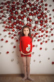 little cute girl on christmas balls background Stock Photos