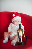 Little cute girl in a Christmas cap Stock Image