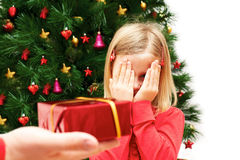 Little cute girl with Christmas present Royalty Free Stock Photography