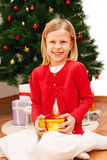 Little cute girl with Christmas present Royalty Free Stock Image