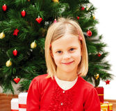 Little cute girl with Christmas present Stock Image