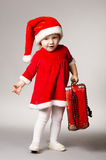 Little cute girl with christmas suitcase Stock Photos