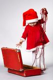 Little cute girl with christmas suitcase Royalty Free Stock Photo
