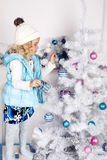 Little cute girl with Christmas tree Stock Photo