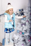 Little cute girl with Christmas tree Royalty Free Stock Image