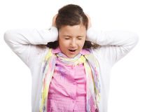Little cute girl closed her ears Stock Image