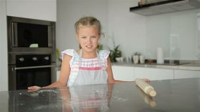 Little Cute Girl Is Cooking On Kitchen. Having Fun While Making Cakes and Cookies. Smiling And Looking At Camera. stock footage