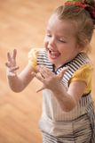 Little cute girl covered with flour laughing Royalty Free Stock Images