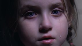 Little cute girl crying desperately, violations of child rights, defenseless kid