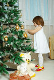 Little cute girl decorating christmas tree Stock Photos