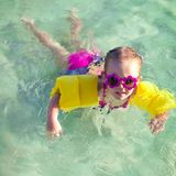 Little cute girl with diving in the sea in nice Stock Image