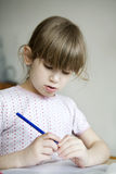 Little cute girl doing homework. Royalty Free Stock Photo
