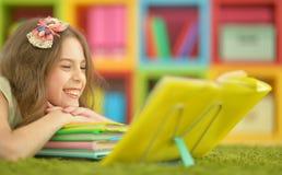 Cute girl doing homework Stock Images